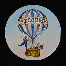 Lantern slide of a hot air ballon with the word Welcome on it